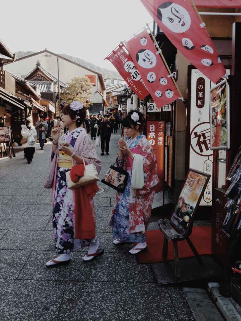two women in yukata near market
