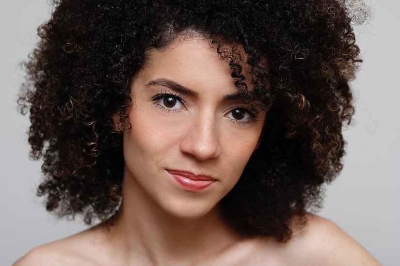portrait photo of curly haired woman