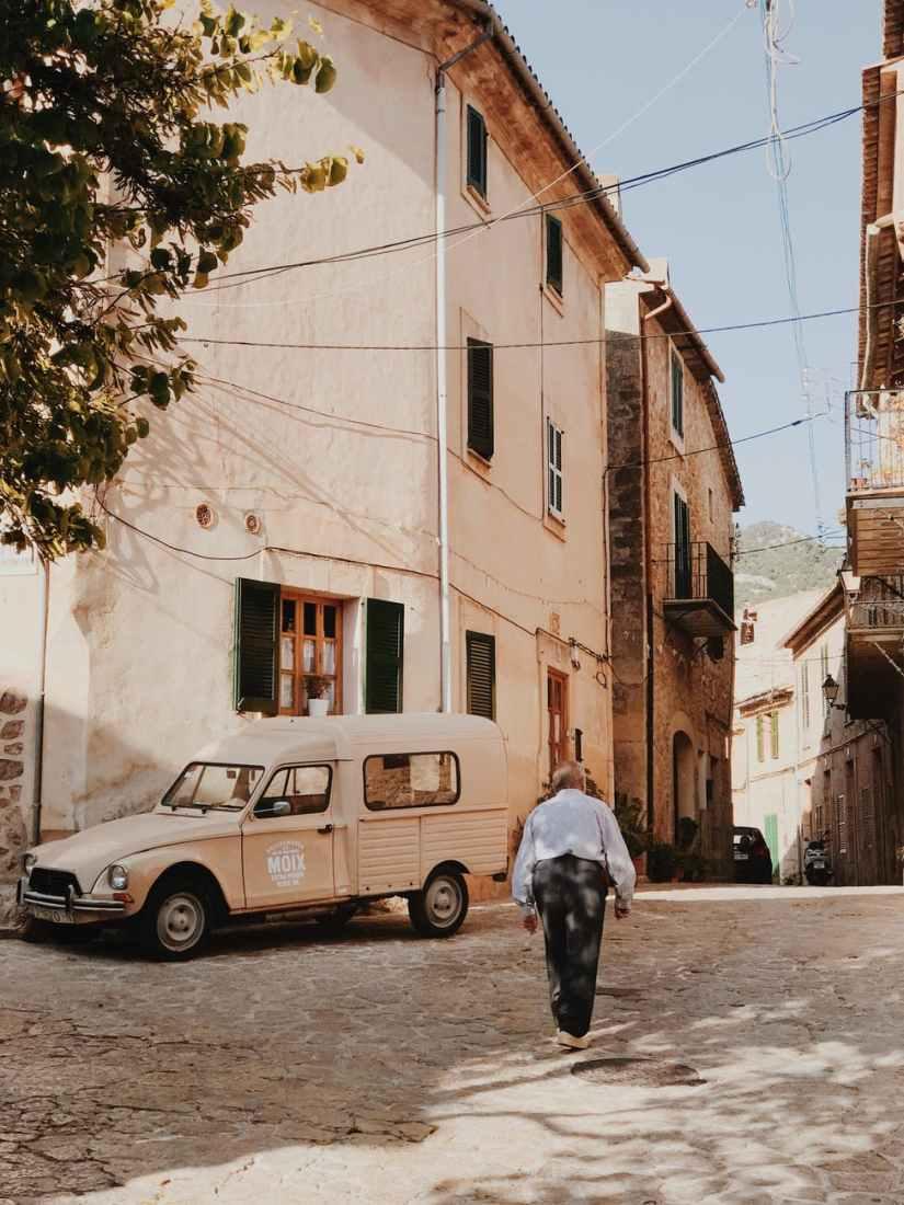 man walking near beige truck