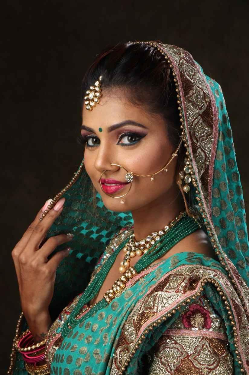woman wearing green brown and pink sari dress portrait photograph