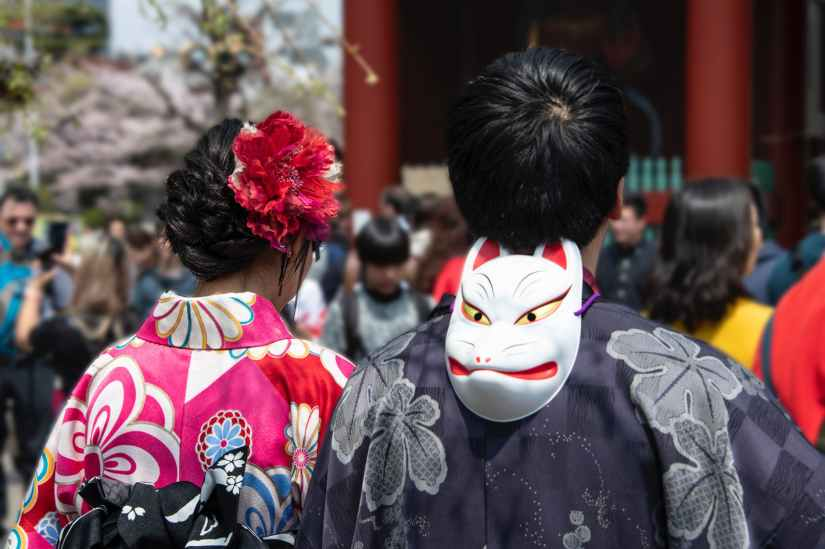 white mask behind man s head