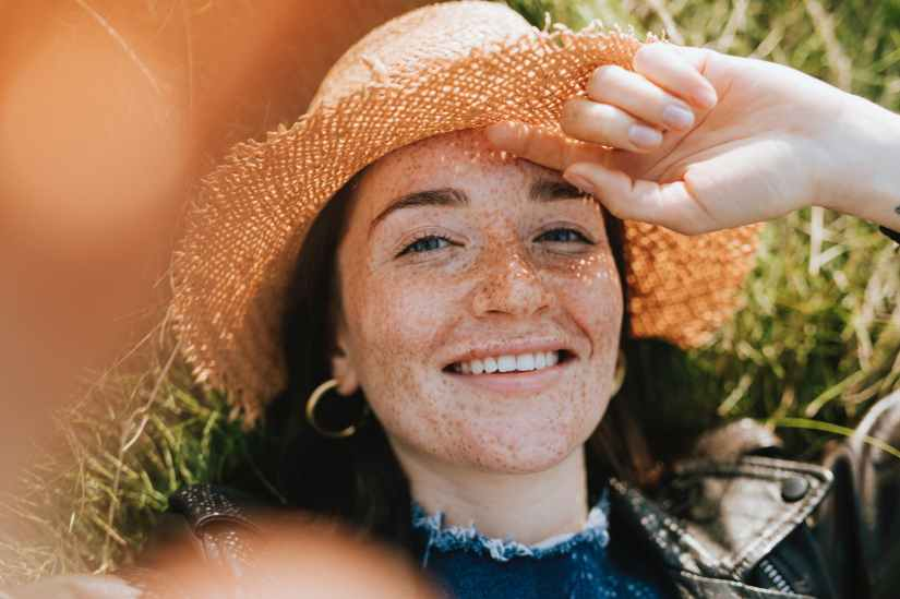 close up photo of woman wearing straw hat
