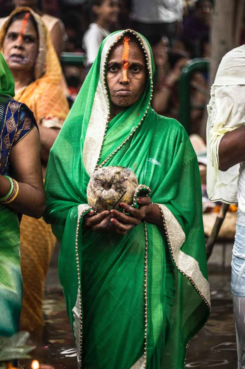 woman holding coconut fruit