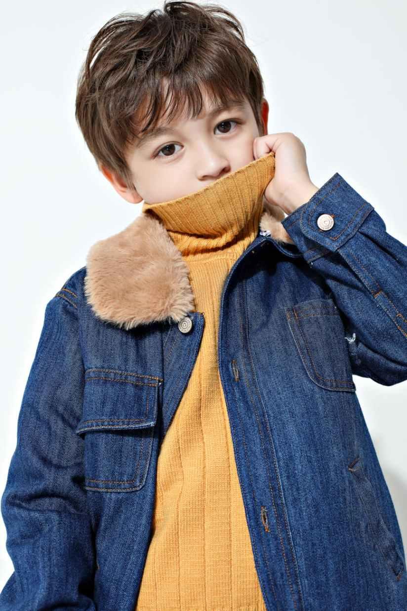 boy wearing blue denim jacket