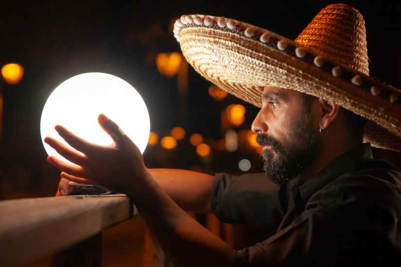 man holding white light