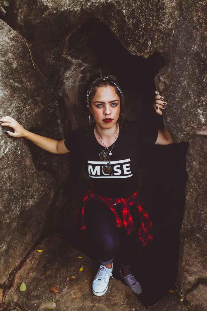 woman standing beside rock fragment