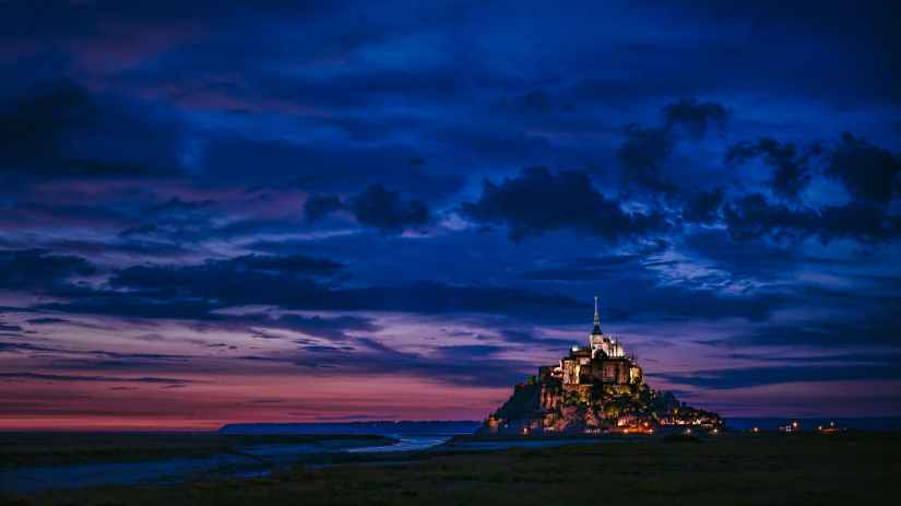 lighted castle at night