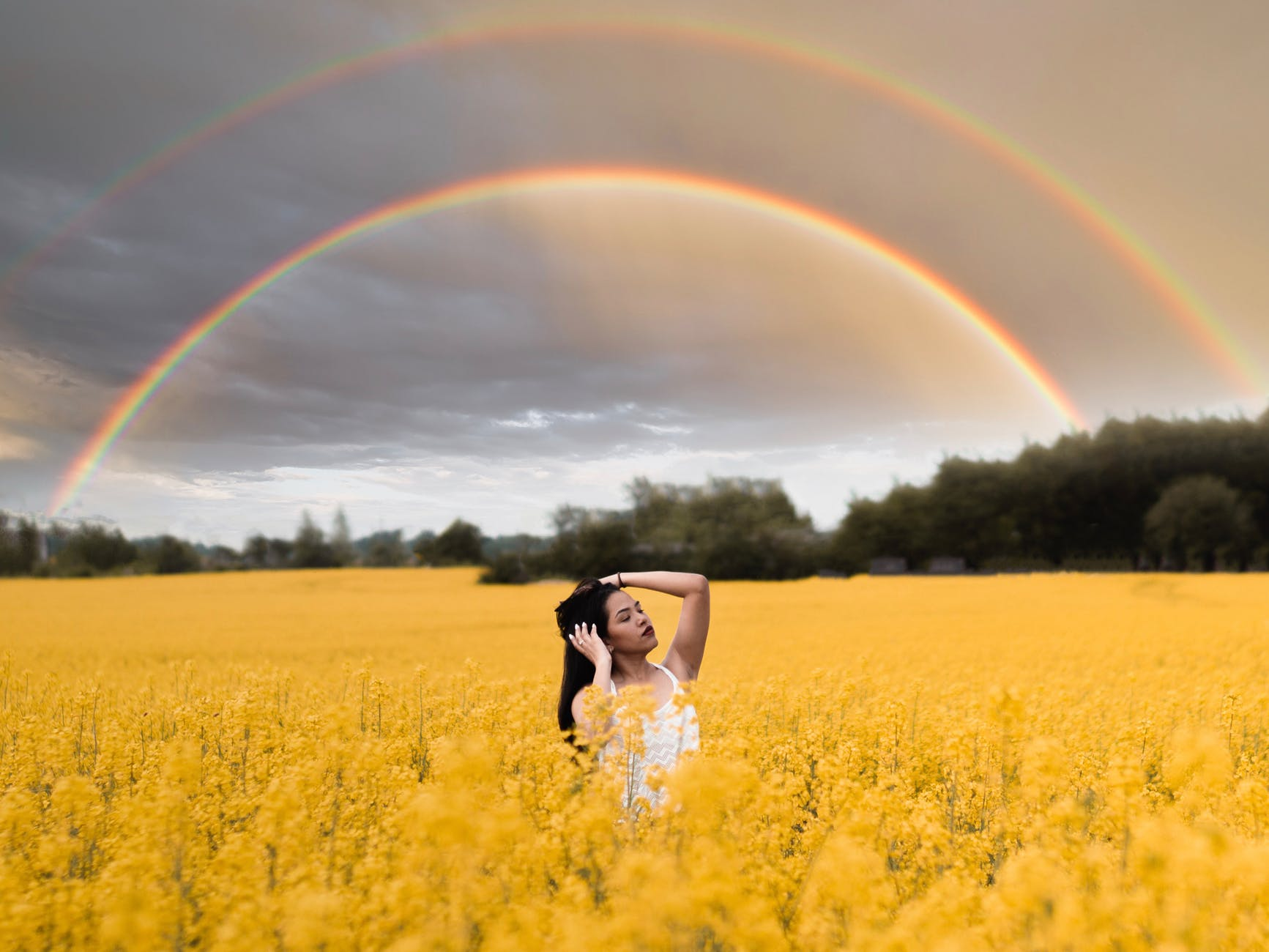 woman standing in the middle of crop field