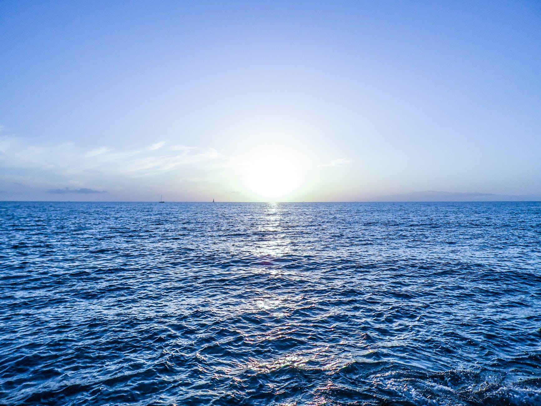 sea and sky horizon photo