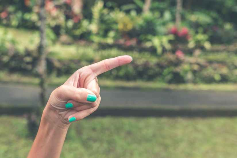 close up photography of a hand pointing