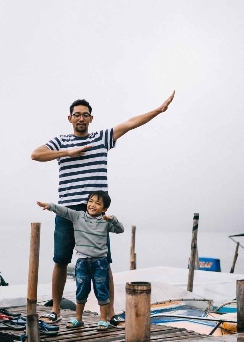 man and boy standing on bridge