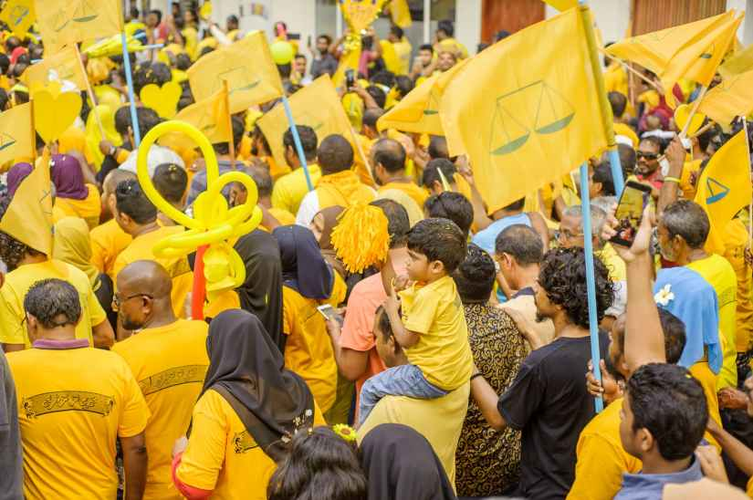crowd of people wearing yellow shirts