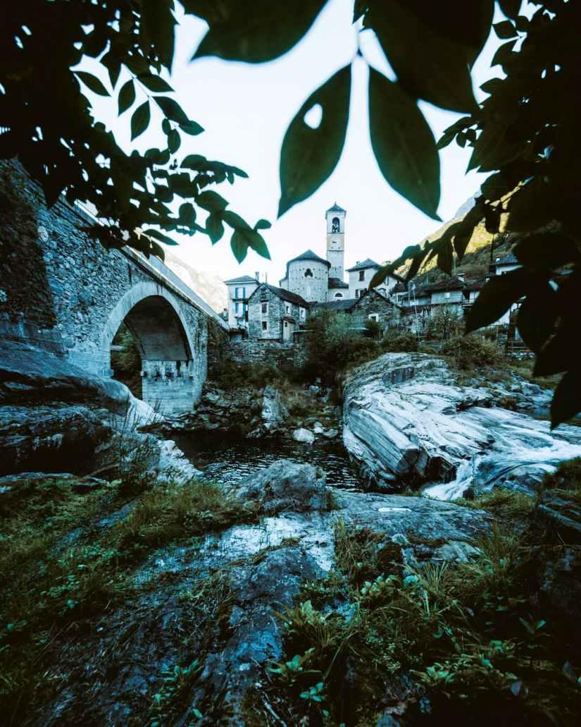 grey stone bridge over rocky river