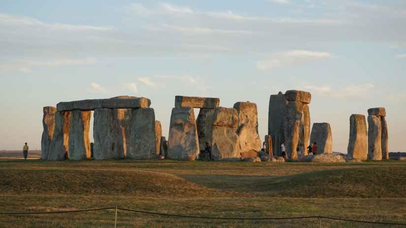 photo of people standing near stonehenge
