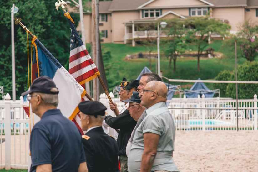 men standing near flags