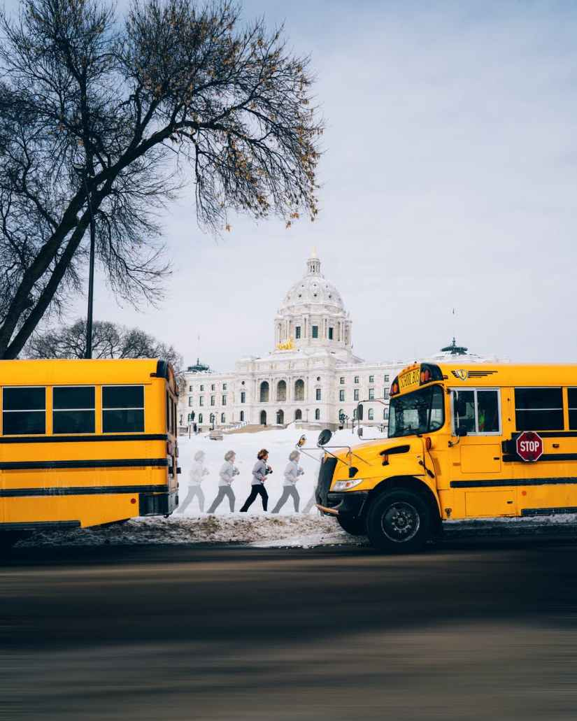 two yellow buses parked near white building