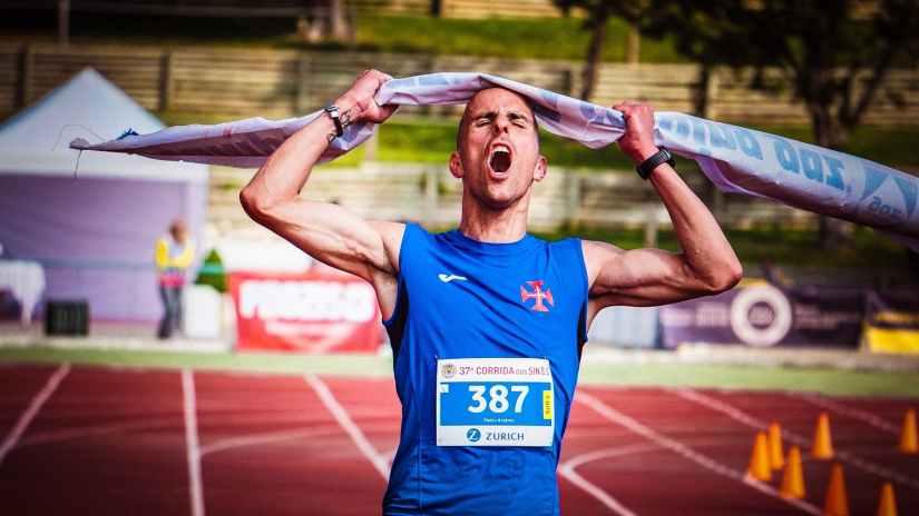 man ripping finish line strap